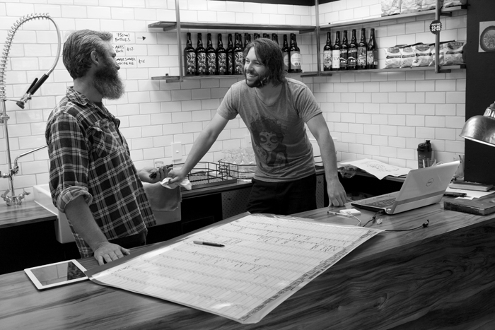 Pete and Jos making plans. Garage Project, Aro Street, Wellington, 2013.
